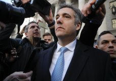 "Michael Cohen walks out of federal court, Thursday, Nov. 29, 2018, in New York. Cohen, President Donald Trump's former lawyer, pleaded guilty to lying to Congress about work he did on an aborted project to build a Trump Tower in Russia. He told the judge he lied about the timing of the negotiations and other details to be consistent with Trump's ""political message."" (AP Photo/Julie Jacobson)"