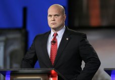 FILE - In this April 24, 2014, file photo, then-Iowa Republican senatorial candidate and former U.S. Attorney Matt Whitaker watches before a live televised debate in Johnston, Iowa. Maryland is challenging the appointment of Matthew Whitaker as the new U.S. acting attorney general. A draft filing obtained Tuesday by The Associated Press argues that President Donald Trump sidestepped the Constitution and normal procedure by naming Whitaker to the position in place of Deputy Attorney General Rod Rosenstein. (AP Photo/Charlie Neibergall, File)