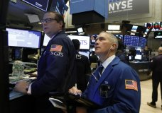FILE- In this Oct. 24, 2018, file photo specialist Gregg Maloney, left, and trader Timothy Nick work on the floor of the New York Stock Exchange. The U.S. stock market opens at 9:30 a.m. EDT on Friday, Nov. 2. (AP Photo/Richard Drew, File)