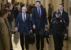 Former FBI Director James Comey, with his attorney, David Kelley, left, arrive to testify under subpoena behind closed doors before the House Judiciary and Oversight Committee on Capitol Hill in Washington, Friday, Dec. 7, 2018. (AP Photo/J. Scott Applewhite)