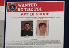 A poster displayed during a news conference at the Department of Justice in Washington, Thursday, Dec. 20, 2018, shows two Chinese citizens suspected to be with the group AP 10 carrying out an extensive hacking campaign to steal data from U.S. companies. The Justice Department is charging two Chinese citizens with carrying out an extensive hacking campaign to steal data from U.S. companies. An indictment was unsealed Thursday against Zhu Hua and Zhang Shillong. Court papers filed in Manhattan federal court allege the hackers were able to breach the computers of more than 45 entities in 12 states. (AP Photo/Manuel Balce Ceneta)