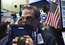 FILE- In this Dec. 12, 2018, file photo trader Gregory Rowe works at the New York Stock Exchange in New York. The U.S. stock market opens at 9:30 a.m. EST on Monday, Dec. 17. (AP Photo/Mark Lennihan, File)