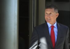 FILE - In this Tuesday, July 10, 2018 file photo, former Trump national security adviser Michael Flynn leaves federal courthouse in Washington, following a status hearing. Flynn is relaxed and hopeful even as the possibility of prison looms when he's sentenced in the Russia probe Tuesday, Dec. 18, 2018. The retired three-star general pleaded guilty last year to lying to the FBI about conversations he had with the then-Russian ambassador to the U.S. during President Donald Trump's White House transition. (AP Photo/Manuel Balce Ceneta, File)