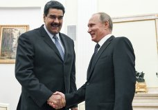 FILE - In this file pool photo taken on Oct. 4, 2017, Russian President Vladimir Putin, right, shakes hands with Venezuela's President Nicolas Maduro during their meeting at the Kremlin in Moscow, Russia. The crisis in Venezuela may have reached a new boiling point, but the geopolitical fault lines look familiar. Russia, China and Iran have thrown their support behind embattled Maduro, while the U.S., Canada and their allies in Western Europe are backing opposition leader Juan Guaido as interim president. (Yuri Kadobnov/Pool Photo via AP, File)