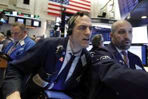 Trader Gregory Rowe, left, works with specialist James Denaro on the floor of the New York Stock Exchange, Tuesday, Jan. 8, 2019. Stocks are opening broadly higher on Wall Street, building on two days of solid gains. (AP Photo/Richard Drew)