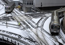"Chicago's El trains move along snow-covered tracks Monday, Jan. 28, 2019, in Chicago. The plunging temperatures expected later this week that have forecasters especially concerned. Wind chills could dip to negative 55 degrees in northern Illinois, which the National Weather Service calls ""possibly life threatening."" (AP Photo/Kiichiro Sato)"