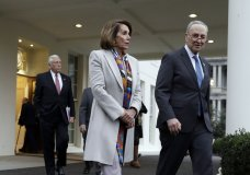 House Democratic leader Rep. Nancy Pelosi of California, and Senate Minority Leader Chuck Schumer, D-N.Y., walk to speak with reporters after a meeting with President Donald Trump on border security at the White House, Wednesday, Jan. 2, 2019, in Washington. (AP Photo/Evan Vucci)