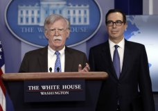 National security adviser John Bolton speaks as Treasury Secretary Steven Mnuchin listens during a press briefing at the White House, Monday, Jan. 28, 2019, in Washington. (AP Photo/ Evan Vucci)