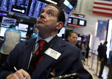 Trader Tommy Kalikas works on the floor of the New York Stock Exchange, Thursday, Jan. 3, 2019. Apple's shock warning that its Chinese sales are weakening ratcheted up concerns about the world's second largest economy and weighed heavily on global stock markets as well as the dollar on Thursday. (AP Photo/Richard Drew)