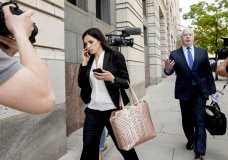 """File - In this May 9, 2018 file photo, Attorneys Eric Dubelier, right, and Katherine Seikaly, left, representing Concord Management and Consulting LLC, walk out of federal court in Washington, after pleading not guilty on behalf of the company, which has been charged as part of a conspiracy to meddle in the 2016 US presidential election. A federal judge on Monday reprimanded Dubelier, saying his references to Looney Tunes and """"Animal House"""" in recent court filings are inappropriate. (AP Photo/Andrew Harnik)"""