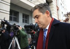 """FILE - In this Nov. 14, 2018 file photo, CNN's Jim Acosta walks into federal court in Washington. The CNN Chief White House Correspondent, who has frequently clashed with President Donald Trump and other officials, has a book coming out June 11. He's calling it """"The Enemy of the People,"""" Trump's inflammatory insult for the cable network and others whose reporting displeases him. HarperCollins Publishers told The Associated Press on Thursday, Jan. 24 2019, that Acosta would describe the """"near-constant conflict"""" in covering Trump and offer portraits of Press Secretary Sarah Huckabee Sanders and others. (AP Photo/Manuel Balce Ceneta)"""