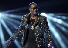"""FILE - In this June 30, 2013 file photo, R. Kelly performs at the BET Awards in Los Angeles. A Georgia man involved with a recent documentary detailing abuse allegations against R. Kelly told police the singer's manager threatened him. A Stockbridge police report says Timothy Savage told an officer on Jan. 3 that Don Russell had texted him saying it would be best for him and his family if the documentary didn't air. Savage said he and his wife were involved with Lifetime's """"Surviving R. Kelly"""" series. (Photo by Frank Micelotta/Invision/AP, File)"""