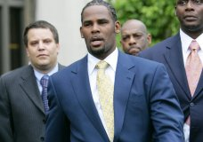 FILE - In this June 13, 2008 file photo, R&B singer R. Kelly leaves the Cook County Criminal Court Building in Chicago after a jury found him not guilty on all counts in his child pornography trial. In 2002, Kelly was indicted on 21 counts of child pornography, based on a videotape allegedly showing him having sex with an underage girl. (AP Photo/Nam Y. Huh, File)