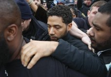 """""""Empire"""" actor Jussie Smollett leaves Cook County jail following his release, Thursday, Feb. 21, 2019, in Chicago. Smollett was charged with disorderly conduct and filling a false police report when he said he was attacked in downtown Chicago by two men who hurled racist and anti-gay slurs and looped a rope around his neck, a police official said. (AP Photo/Kamil Krzaczynski)"""
