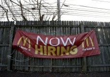 FILE- In this Jan. 3, 2019, file photo an employment sign hangs from a wooden fence on the property of a McDonald's restaurant in Atlantic Highlands, N.J. On Friday, Feb. 1, the U.S. government issues the January jobs report, which will reveal the latest unemployment rate and number of jobs U.S. employers added. (AP Photo/Julio Cortez, File)