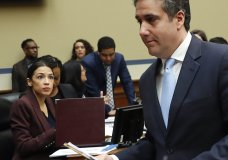 Michael Cohen, right, President Donald Trump's former lawyer, walks past committee member Rep. Alexandria Ocasio-Cortez, D-N.Y., center, during a break in Cohen's testimony before the House Oversight and Reform Committee on Capitol Hill in Washington, Wednesday, Feb. 27, 2019. (AP Photo/Pablo Martinez Monsivais)
