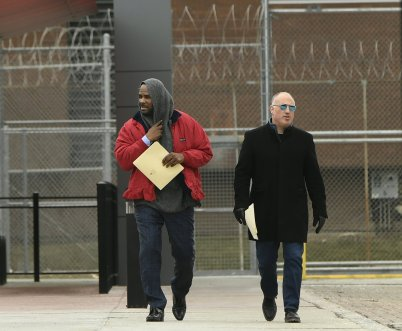 Singer R. Kelly left, walks with his attorney Steve Greenberg right, after being released from Cook County Jail, March 9, 2019, in Chicago. Kelly was freed three days after a judge ordered him jailed until he paid the total amount of back child support that he owed. Kelly was freed Saturday, three days after a judge ordered him jailed until he paid the total amount of back child support that he owed. (AP Photo/Paul Beaty)