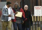 Singer R. Kelly center, walks with his attorney Steve Greenberg right, and an unidentified man left, who gave him a ride after being released from Cook County Jail, March 9, 2019, in Chicago. Kelly was freed three days after a judge ordered him jailed until he paid the total amount of back child support that he owed. (AP Photo/Paul Beaty)