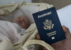n this photo taken on Jan. 24, 2019, Denis Wolok, the father of 1-month-old Eva's father, shows the child's U.S. passport during an interview with The Associated Press in Hollywood, Fla. Every year, hundreds of pregnant Russian women, like Wolok's wife, Olga Zemlyanaya, travel to the United States to give birth so that their child can acquire all the privileges of American citizenship. (AP Photo/Iuliia Stashevska)