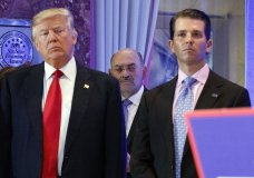 FILE - In this Jan. 11, 2017, file photo, Allen Weisselberg, center, stands between President-elect Donald Trump, left, and Donald Trump Jr., at a news conference in the lobby of Trump Tower in New York. Weisselberg, chief financial officer for Donald Trump, is now in the sights of the federal probes and congressional investigations of President Donald Trump's family business. (AP Photo/Evan Vucci, File)