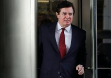 FILE - In this file photo taken on Monday, Nov. 6, 2017, Paul Manafort, President Donald Trump's former campaign chairman, leaves the federal courthouse in Washington. Russian state television stations have jumped at what they perceive as a relatively mild sentence handed to former Trump campaign chairman Paul Manafort, saying it is proof that U.S. special counsel Robert Mueller's investigations have failed to prove Trump's collusion with Russia. (AP Photo/Jacquelyn Martin, File)
