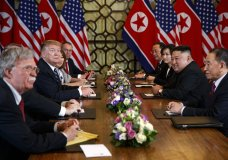 President Donald Trump speaks during a meeting with North Korean leader Kim Jong Un Thursday, Feb. 28, 2019, in Hanoi. At front right is Kim Yong Chol, a North Korean senior ruling party official and former intelligence chief. At left is national security adviser John Bolton. (AP Photo/ Evan Vucci)