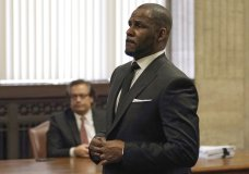 R Kelly appears for a hearing at the Leighton Criminal Court Building on Friday, March 22, 2019 in Chicago. An overseas trip by R. Kelly is in limbo after his criminal attorney asked for more time to provide details to the court about concerts the singer wants to perform next month in Dubai. (E. Jason Wambsgans/Chicago Tribune via AP, Pool)