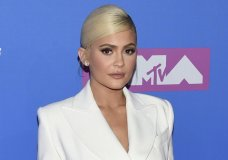 FILE - In this Monday, Aug. 20, 2018 file photo, Kylie Jenner arrives at the MTV Video Music Awards at Radio City Music Hall in New York. At 21, Jenner has been named the youngest-ever, self-made billionaire by Forbes magazine in March 2019. (Photo by Evan Agostini/Invision/AP)