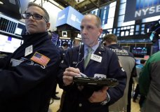 ILE- In this March 7, 2019, file photo specialist Anthony Rinaldi, left, and trader Michael Urkonis work on the floor of the New York Stock Exchange. The U.S. stock market opens at 9:30 a.m. EDT on Friday, March 29. (AP Photo/Richard Drew, File)
