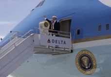 """President Donald Trump and first lady Melania Trump arrive at Hartsfield-Jackson International Airport to attend the """"Rx Drug Abuse and Heroin Summit,"""" Wednesday, April 24, 2019, in Atlanta. (AP Photo/Evan Vucci)"""