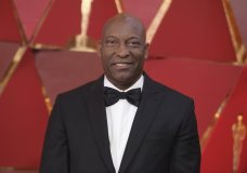 "FILE - This March 4, 2018 file photo shows John Singleton at the Oscars in Los Angeles. The family for Singleton says the filmmaker will be taken off life support Monday, April 29, 2019, after suffering a stroke almost two weeks ago. In a statement Monday, Singleton's family said it was ""an agonizing decision, one that our family made over a number of days with the careful counsel of John's doctors."" (Photo by Richard Shotwell/Invision/AP, File)"