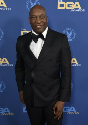 "FILE - This Feb. 2, 2019 file photo shows John Singleton at the 71st annual DGA Awards in Los Angeles. The family for Singleton says the filmmaker will be taken off life support Monday, April 29, 2019, after suffering a stroke almost two weeks ago. In a statement Monday, Singleton's family said it was ""an agonizing decision, one that our family made over a number of days with the careful counsel of John's doctors."" (Photo by Chris Pizzello/Invision/AP, File)"