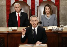 NATO Secretary General Jens Stoltenberg, accompanied by Vice President Mike Pence, left, and House Speaker Nancy Pelosi of Calif., right, addresses a Joint Meeting of Congress on Capitol Hill in Washington, Wednesday, April 3, 2019, having been invited by the bipartisan leadership of the House of Representatives and the Senate. (AP Photo/Patrick Semansky)