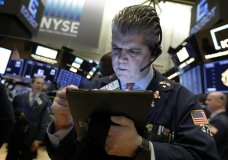 FILE - In this Feb. 5, 2019, file photo, trader John Panin works on the floor of the New York Stock Exchange. On Wednesday, April 24, stocks are opening slightly lower on Wall Street, a day after the S&P 500 surpassed the record high close it set in September. (AP Photo/Richard Drew, File)