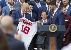 Outfielder J.D. Martinez, right, presents a team jersey to President Donald Trump, left, during a ceremony on the South Lawn of the White House in Washington, Thursday, May 9, 2019, where Trump honored the 2018 World Series Baseball Champion Boston Red Sox. (AP Photo/Pablo Martinez Monsivais)
