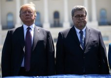 President Donald Trump stands with Attorney General William Barr during the 38th Annual National Peace Officers' Memorial Service at the U.S. Capitol, Wednesday, May 15, 2019, in Washington. (AP Photo/Evan Vucci)