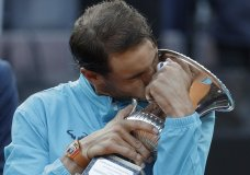 Rafael Nadal of Spain kisses his trophy after winning against Novak Djokovic of Serbia at the end of their final match at the Italian Open tennis tournament, in Rome, Sunday, May 19, 2019. (AP Photo/Gregorio Borgia)