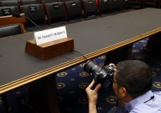 A photojournalist photographs a name placard for former White House Counsel Don McGahn, who is not expected to appear before a House Judiciary Committee hearing, Tuesday, May 21, 2019, on Capitol Hill in Washington. (AP Photo/Patrick Semansky)