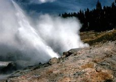 This recent but undated photo provided by the National Park Service shows Ledge Geyser in Yellowstone National Park, within days of its most recent eruption that began on April 28, 2019. The noisy geyser in Yellowstone has roared back to life after three years of quiet. Ledge Geyser is one of the biggest in Yellowstone's Norris Geyser Basin. The Billings Gazette reports the geyser shoots hot water at an angle up to 125 feet high and a distance of 220 feet. (National Park Service via AP)