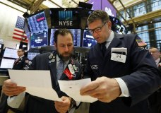 FILE - In this May 14, 2019, file photo specialists Michael Pistillo, left, and David Haubner confer on the floor of the New York Stock Exchange. The U.S. stock market opens at 9:30 a.m. EDT on Thursday, June 6. (AP Photo/Richard Drew, File)