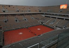 A near empty center court Philippe Chatrier is seen rain interrupted the quarterfinal match of the French Open tennis tournament between Japan's Kei Nishikori and Spain's Rafael Nadal at the Roland Garros stadium in Paris, Tuesday, June 4, 2019. (AP Photo/Pavel Golovkin)