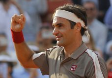 Switzerland's Roger Federer celebrates winning his quarterfinal match of the French Open tennis tournament against Switzerland's Stan Wawrinka in four sets, 7-6 (7-4), 4-6, 7-6 (7-5), 6-4, at the Roland Garros stadium in Paris, Tuesday, June 4, 2019. (AP Photo/Michel Euler)