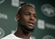 In this Tuesday, June 4, 2019, photo, New York Jets running back Le'Veon Bell speaks to reporters at the team's NFL football training facility in Florham Park, N.J. Authorities say two female acquaintances stole more than half a million dollar in jewelry from Bell at his Florida home. (AP Photo/Julio Cortez)