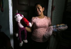 Rosa Ramirez sobs as she shows journalists toys that belonged to her nearly 2-year-old granddaughter Valeria in her home in San Martin, El Salvador, Tuesday, June 25, 2019. The drowned bodies of Ramirez's son, 25-year-old Oscar Alberto Martinez Ramirez, and his daughter were located Monday morning on the banks of the Rio Grande, a day after the pair were swept away by the current when the young family tried to cross the river to Brownsville, Texas. Her daughter-in-law Tania Vanessa Avalos, 21, survived. (AP Photo/Antonio Valladares)
