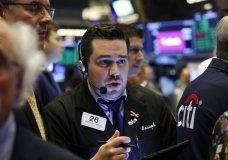 Trader Joseph Lawler works on the floor of the New York Stock Exchange, Thursday, June 20, 2019. (AP Photo/Richard Drew)