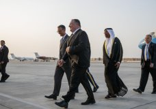 Secretary of State Mike Pompeo, center, walks with U.S. Charge d'Affaires Steve Bondy, left, and United Arab Emirates Minister of State Ahmed al-Sayegh, right, as Pompeo arrives in Abu Dhabi, United Arab Emirates, Monday, June 24, 2019, for talks on Iran. (AP Photo/Jacquelyn Martin, Pool)