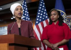 """U.S. Rep. Ilhan Omar, D-Minn., joined at right by U.S. Rep. Ayanna Pressley, D-Mass., responds to remarks by President Donald Trump after he called for four Democratic congresswomen of color to go back to their """"broken"""" countries, as he exploited the nation's glaring racial divisions once again for political gain, during a news conference at the Capitol in Washington, Monday, July 15, 2019. All four congresswomen are American citizens and three of the four were born in the U.S. Omar is the first Somali-American in Congress. (AP Photo/J. Scott Applewhite)"""