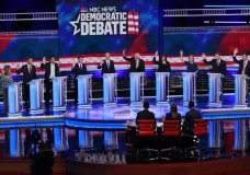 In this June 27, 2019 photo, Democratic presidential candidates, author Marianne Williamson, former Colorado Gov. John Hickenlooper, entrepreneur Andrew Yang, South Bend Mayor Pete Buttigieg, former Vice President Joe Biden, Sen. Bernie Sanders, I-Vt., Sen. Kamala Harris, D-Calif., Sen. Kirsten Gillibrand, D-N.Y., Colorado Sen. Michael Bennet, and Rep. Eric Swalwell, D-Calif., raise their hands when asked if they would provide healthcare for undocumented immigrants, during the Democratic primary debate hosted by NBC News at the Adrienne Arsht Center for the Performing Arts in Miami. (AP Photo/Wilfredo Lee)