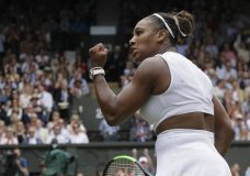 United States' Serena Williams celebrates defeating United States' Alison Riske during a women's quarterfinal match on day eight of the Wimbledon Tennis Championships in London, Tuesday, July 9, 2019. (AP Photo/Kirsty Wigglesworth)