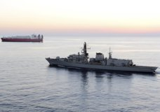"""n this image from file video provided by UK Ministry of Defence, British navy vessel HMS Montrose escorts another ship during a mission to remove chemical weapons from Syria at sea off coast of Cyprus in February 2014. The British Navy said it intercepted an attempt on Thursday, July 11, 2019, by three Iranian paramilitary vessels to impede the passage of a British commercial vessel just days after Iran's president warned of repercussions for the seizure of its own supertanker. A U.K. government statement said Iranian vessels only turned away after receiving """"verbal warnings"""" from the HMS Montrose accompanying the commercial ship through the narrow Strait of Hormuz. (UK Ministry of Defence via AP)"""